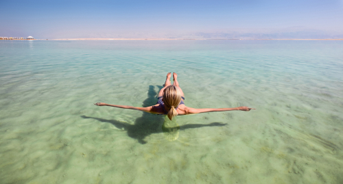 Blonde,Woman,Floating,In,The,Turquoise,Waters,Of,The,Dead